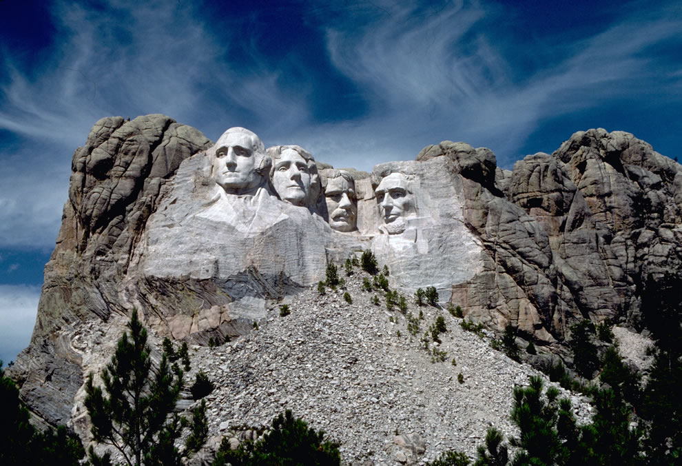Colossal heads of Presidents George Washington, Thomas Jefferson, Theodore Roosevelt, and Abraham Lincoln were sculpted by Gutzon Borglum on the face of a granite mountain