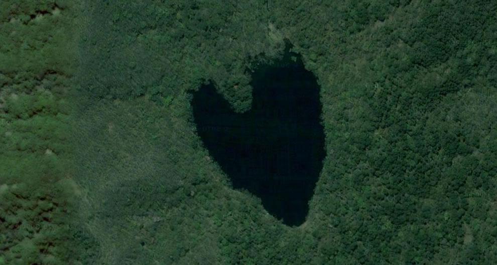 Flipped aerial image of a lake shaped like a heart on the island of Hokaido, Japan