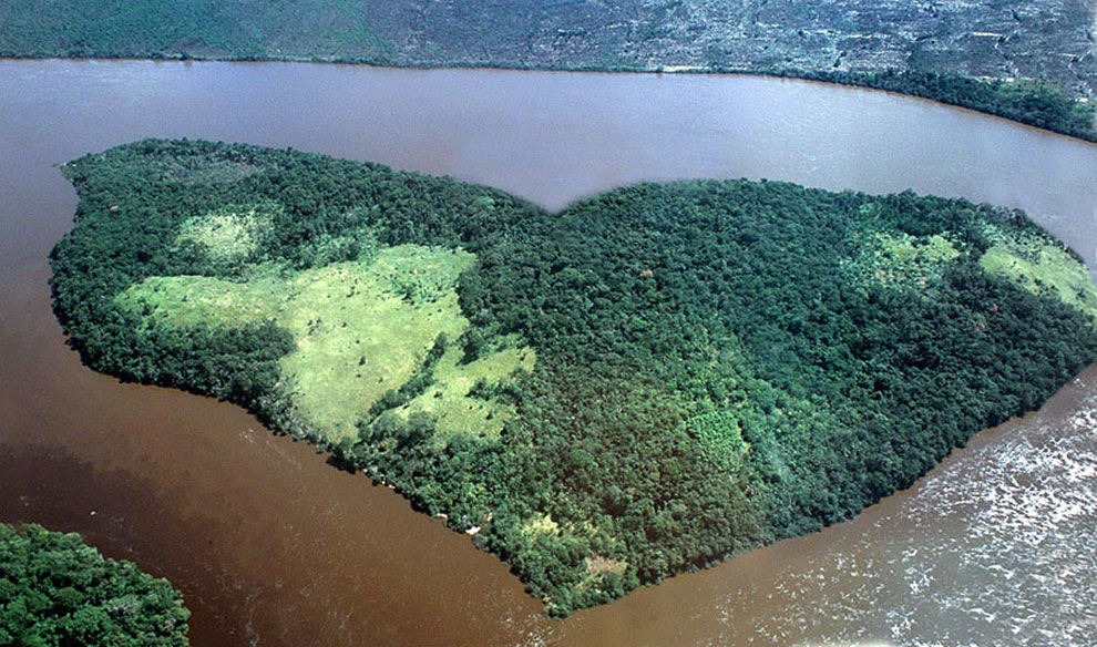 Mostly forested heart-shaped island as seen flying over the Orinoco river in Ciudad Bolívar, Venezuela