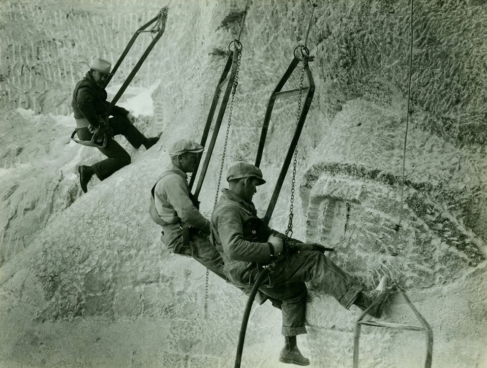 Mount Rushmore construction workers hanging by cables