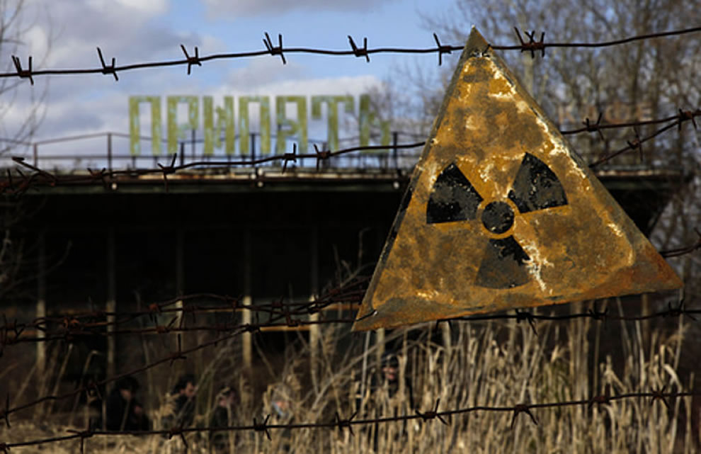 A radioactive sign hangs on barbed wire outside a café in Pripyat, March 2011