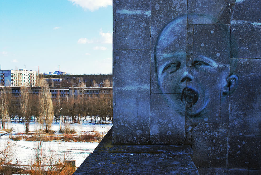 Graffiti and view from the Pripyat hotel roof, March 2011