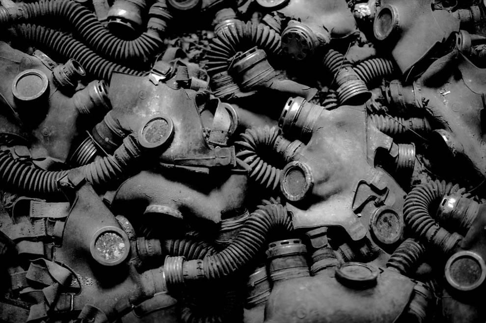 October 2012 Photojournalism - abandoned gas masks litter the floor of a building in Pripyat - Chernobyl, Urkaine