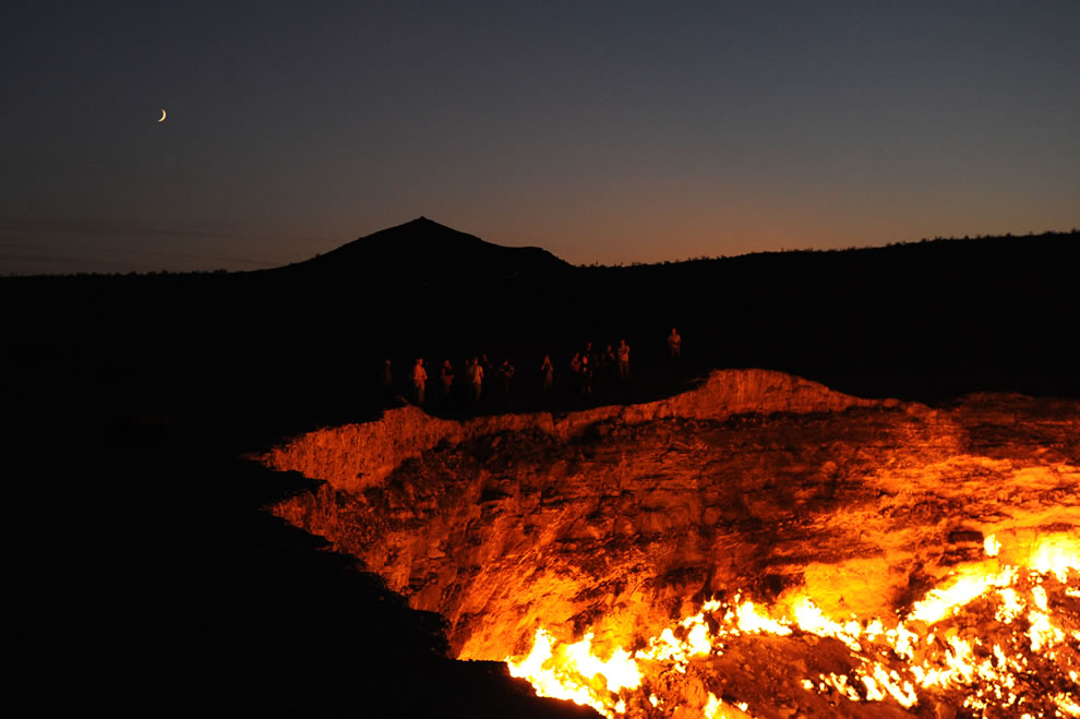 Standing on the edge of the Door to Hell, Darvasa gas crater in Turkmenistan