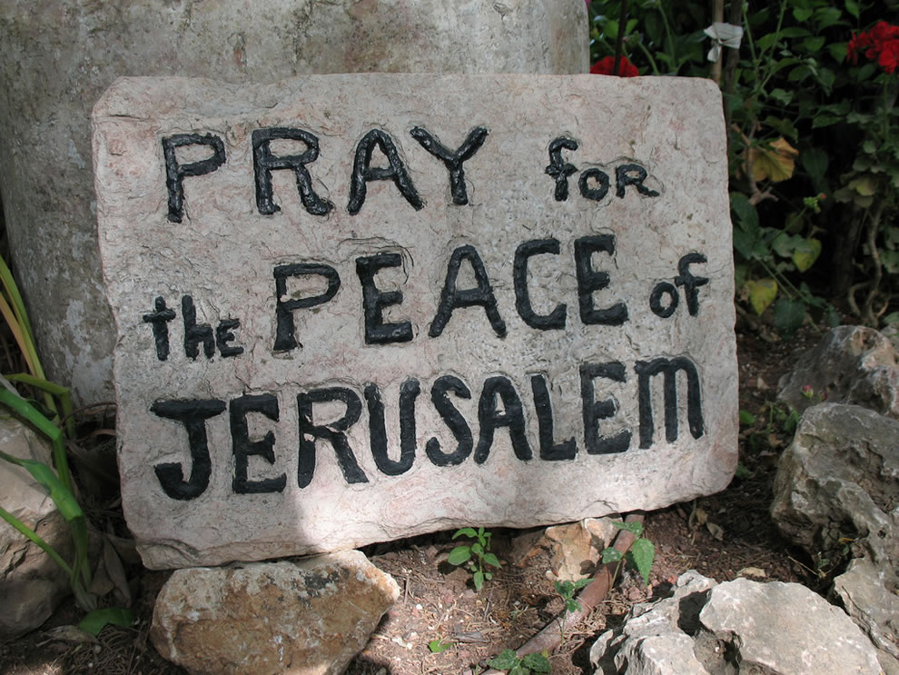 This rock sign, Pray for the peace of Jerusalem, is on the Garden Tomb grounds