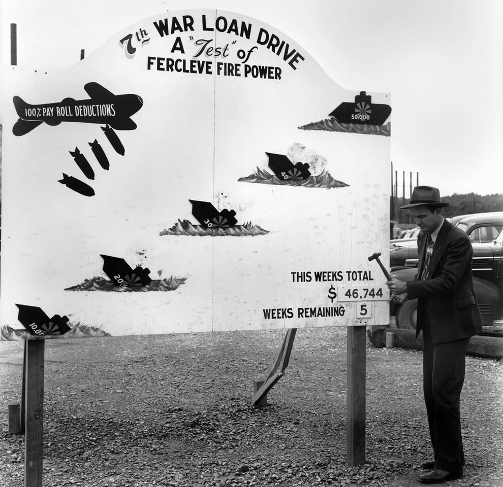 Billboard showing total payroll deduction for 7th war loan drive Oak Ridge Tennessee