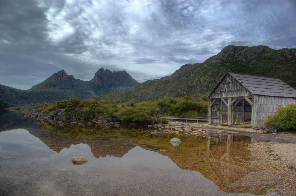 Tasmanian Wilderness World Heritage Area - Classic view of Cradle Mountain over Dove Lake, with old boat shed in foreground