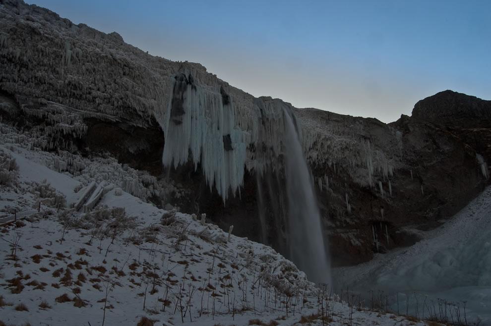 Frozen Iceland, 200 ft Seljalandsfoss waterfall in winter