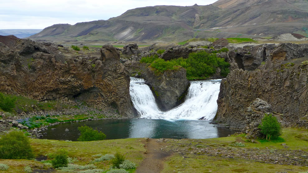 June at Hjálparfoss waterfall in south Iceland