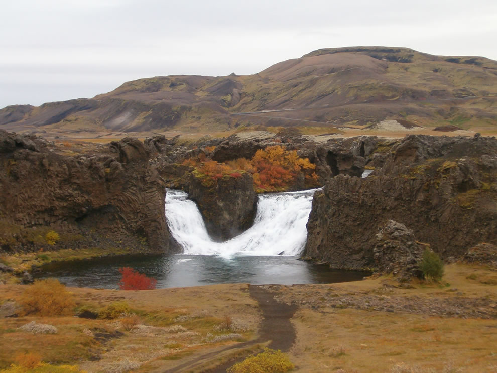 October view of Hjálparfoss waterfall in Iceland