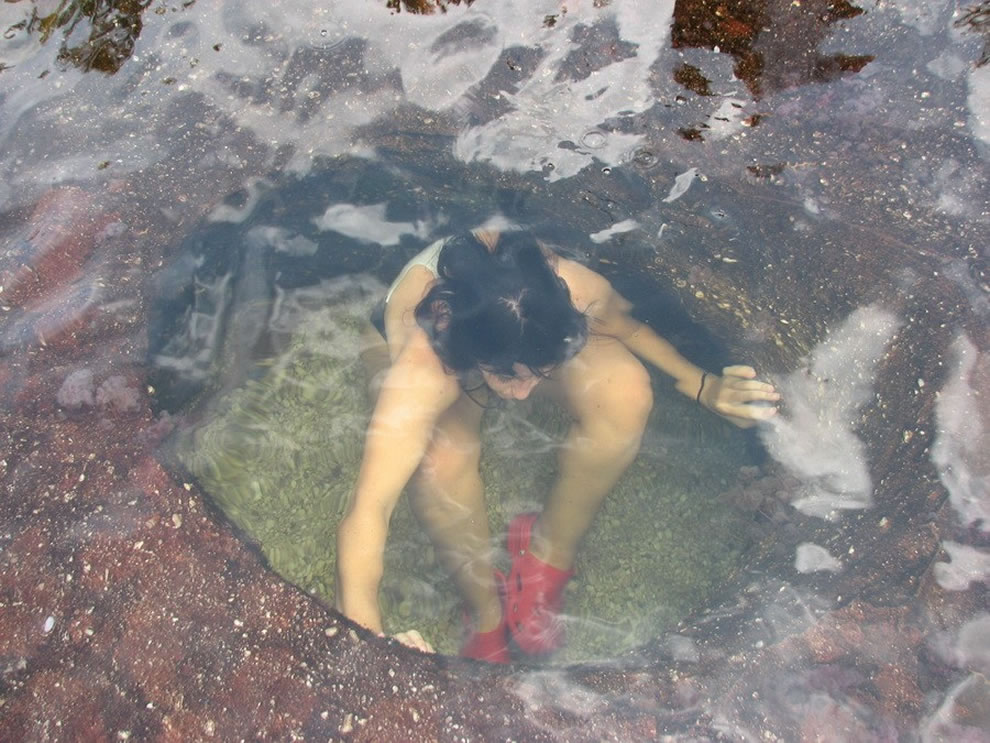 Person submerged in the Cano Cristales, River of 5 Colors, swimming hole