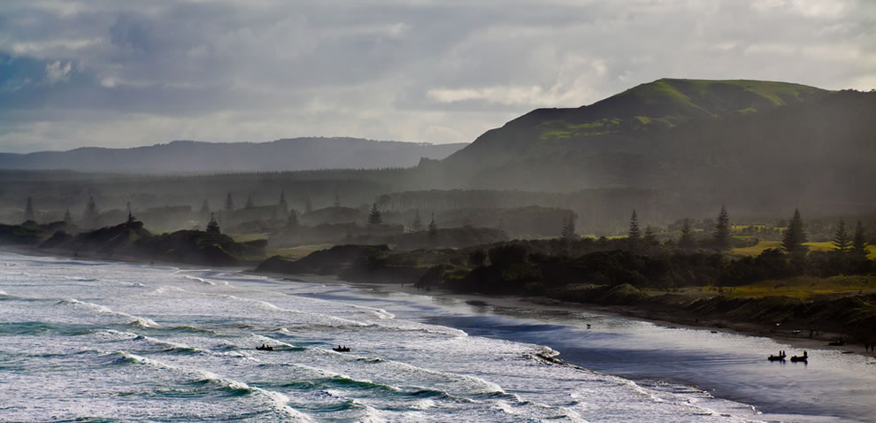 Black sand and Muriwai Beach waves, New Zealand