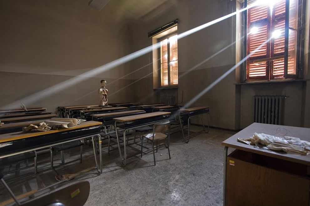 Suns rays into a classroom at an abandoned reform school