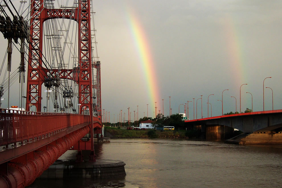 Suspension bridge and double rainbow in Argentina