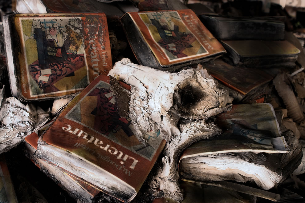 This stack of literature books lay on the third floor burned and rotting at abandoned Detroit Publix Schools Book Depository