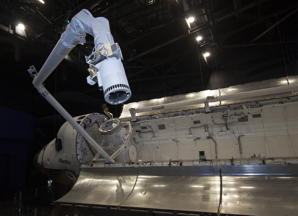 At the Kennedy Space Center Visitor Complex in Florida, space shuttle Atlantis' payload bay doors are open and the robotic arm has been installed in the payload bay