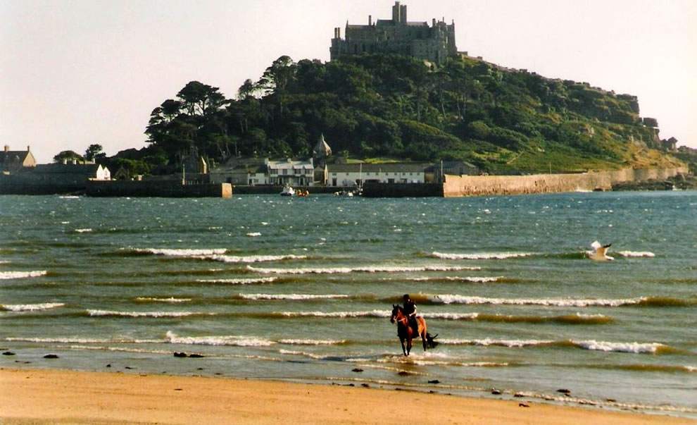 Horse and rider near St. Michael's Mount, a tidal island