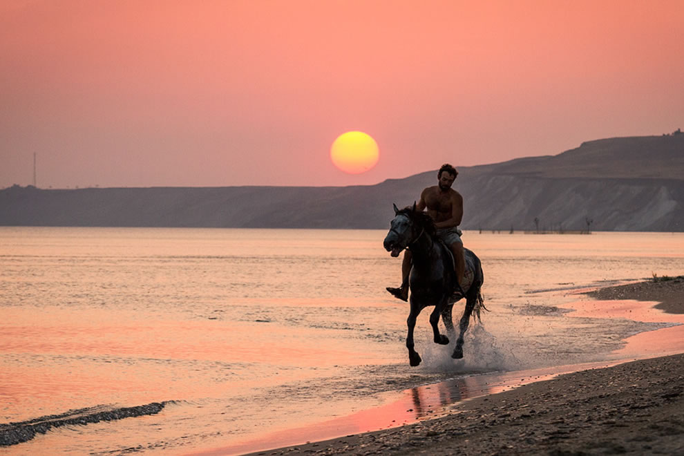 Man on a horse for seaside sunset