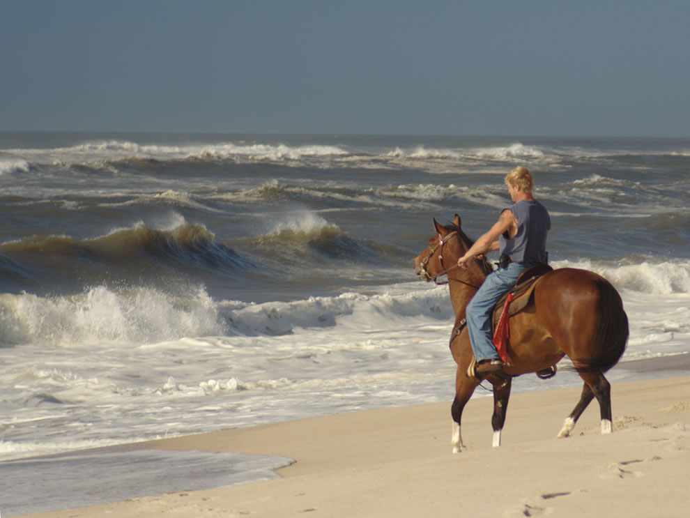 Rider by the Surf after a storm