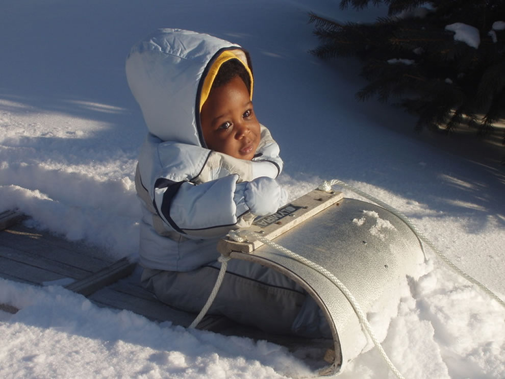 Toddler on sled, cold winter's day