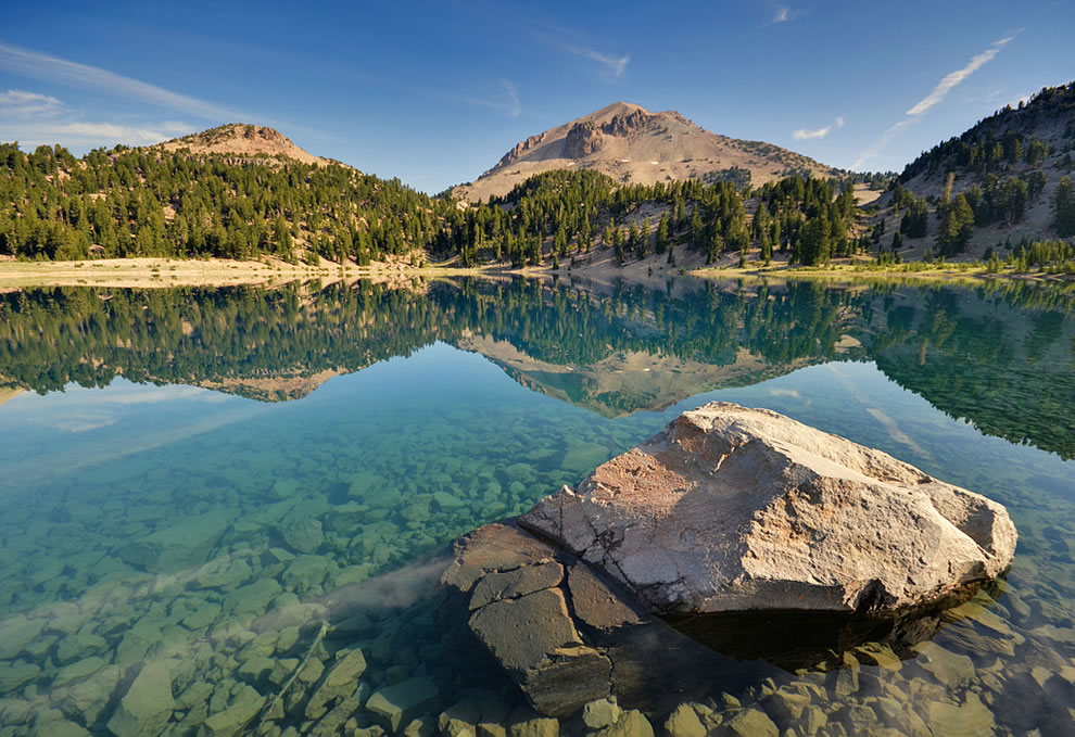 Eagle Peak and Lassen Peak are reflected in the glassy mid-morning waters of Lake Helen, Lassen Volcanic National Park