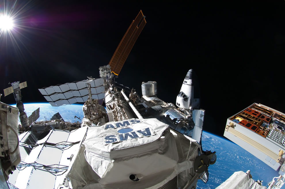 ISS with  Atlantis docked at right and a Russian Soyuz docked to Pirs