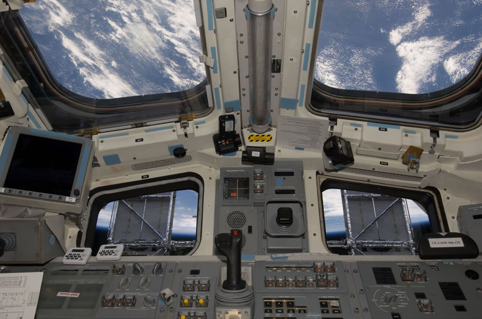 Solar panels on the Hubble Space Telescope make for some unique window shades in this scene photographed from the flight deck of the Earth-orbiting Space Shuttle Atlantis, 2009