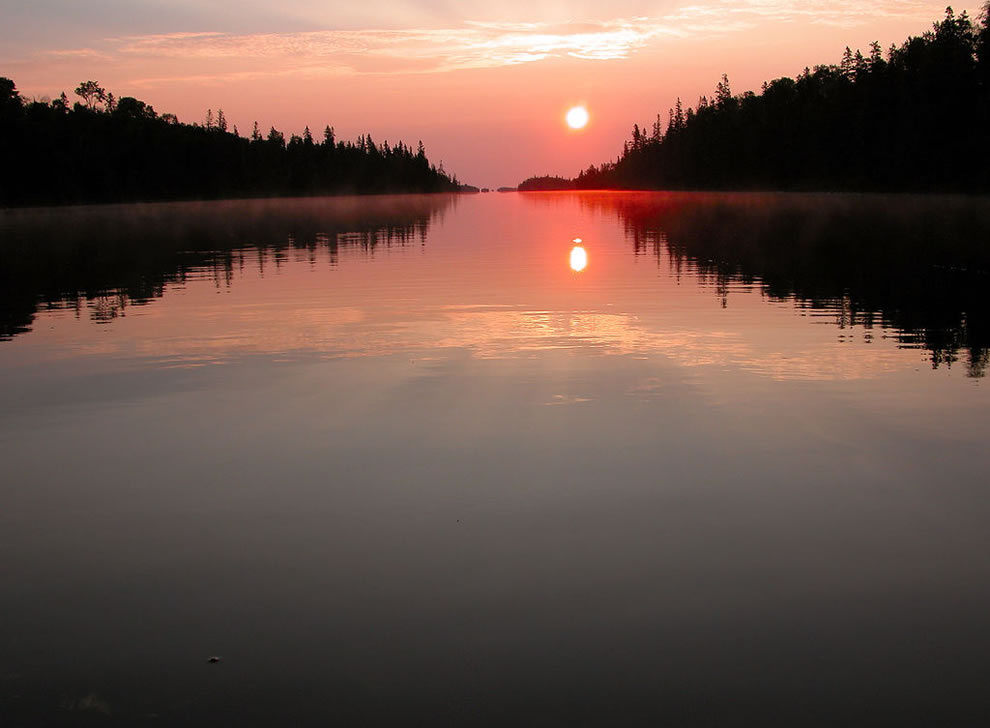 Sunrise on Tobin Harbor at Isle Royale National Park, taken from a canoe
