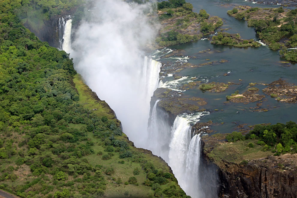 UNESCO World Heritage Site in Africa, Victoria Falls 'the Smoke that Thunders' is the world's largest sheet of falling water