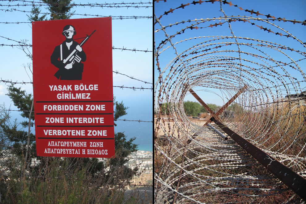Gun in hand warning sign for forbidden zone and barbed wire from accessible area of Famagusta