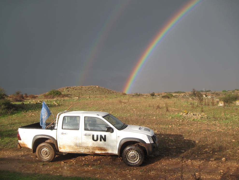 UN truck and double rainbow over the bufferzone