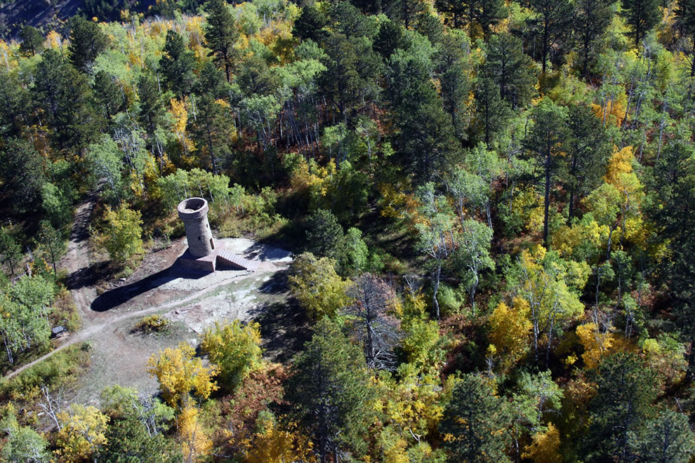Beginning of fall foliage in the Black Hills of South Dakota, aerial view of the Friendship Tower on Mt. Roosevelt