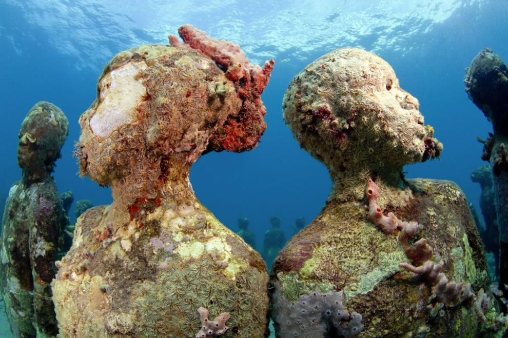Nature taking over the Vicissitudes underwater sculpture, an artificial reef in Grenada