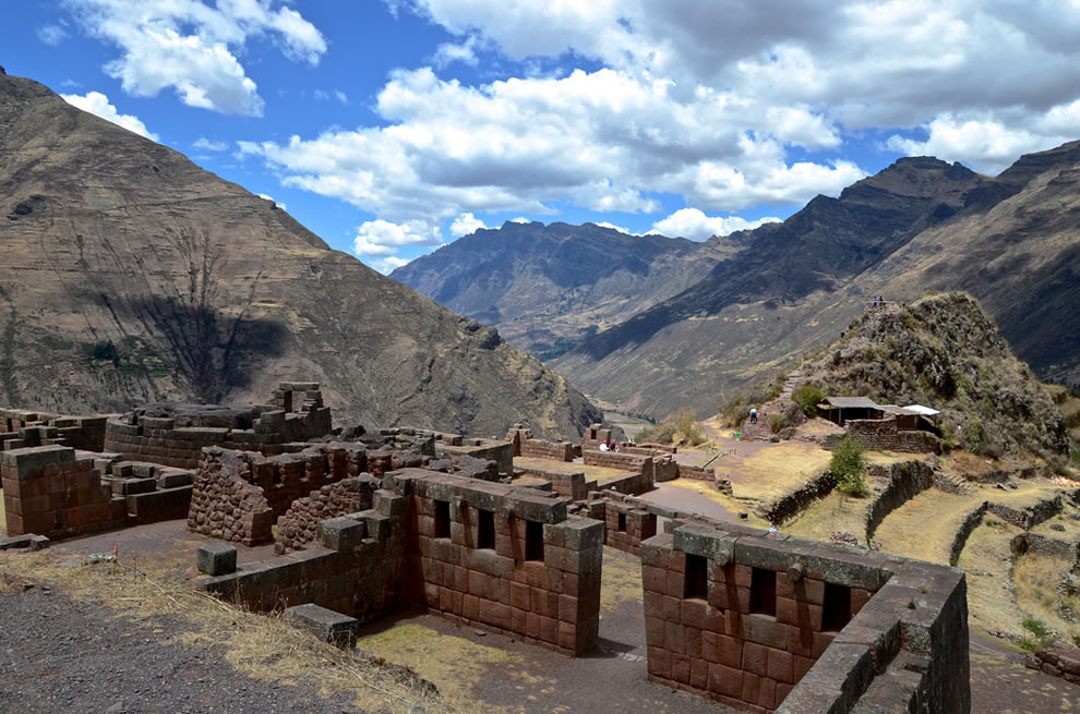 Inca ruins along the mountains by the Sacred Valley in Peru