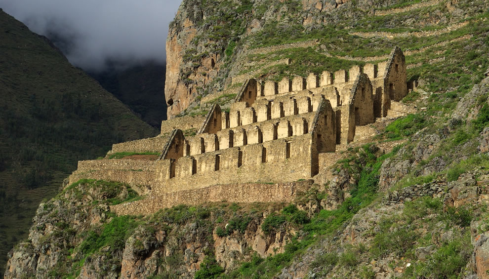Ruins of granaries on the hillside over Ollantaytambo, an Inca archaeological site in the Sacred Valley