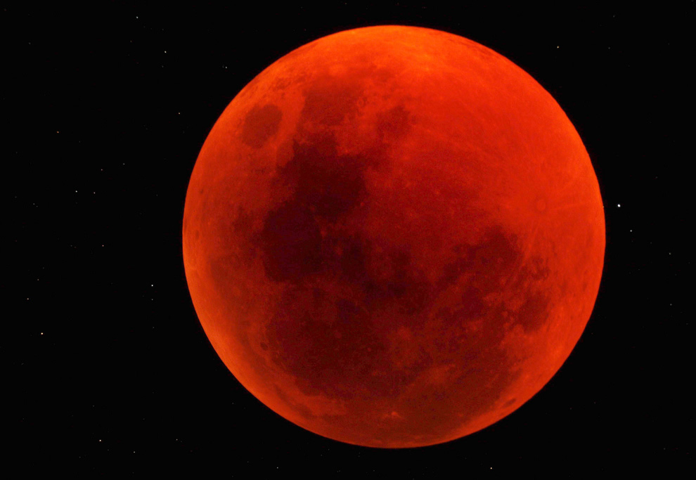 Blood red moon, total lunar eclipse over Namibia Reserve