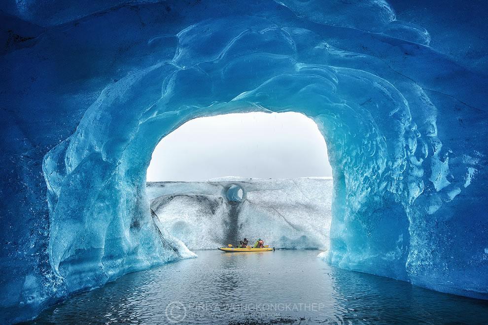 Kayaking inside an ice cave, Glacier Iceberg landscape