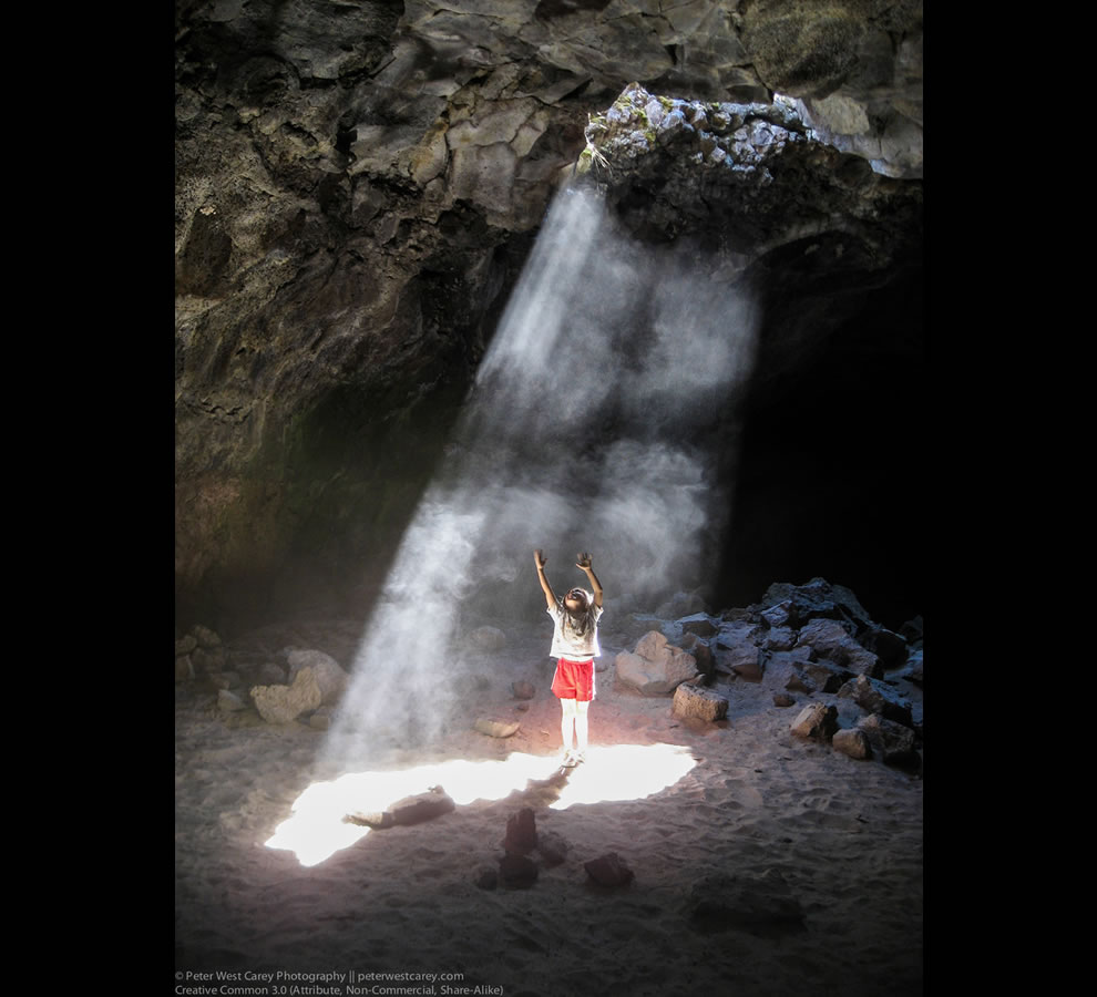 Little girl standing in the sunlight piercing Derek Cave, Oregon