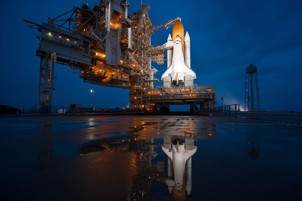 Space Shuttle Atlantis is seen shortly after the rotating service structure was rolled back at launch pad 39a