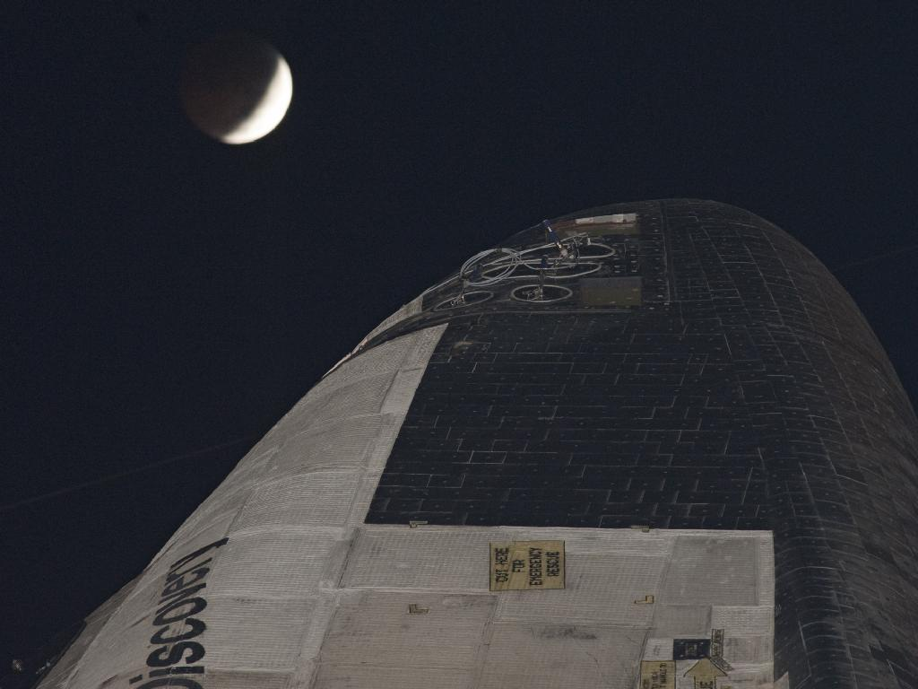 Space shuttle Discovery and the lunar eclipse