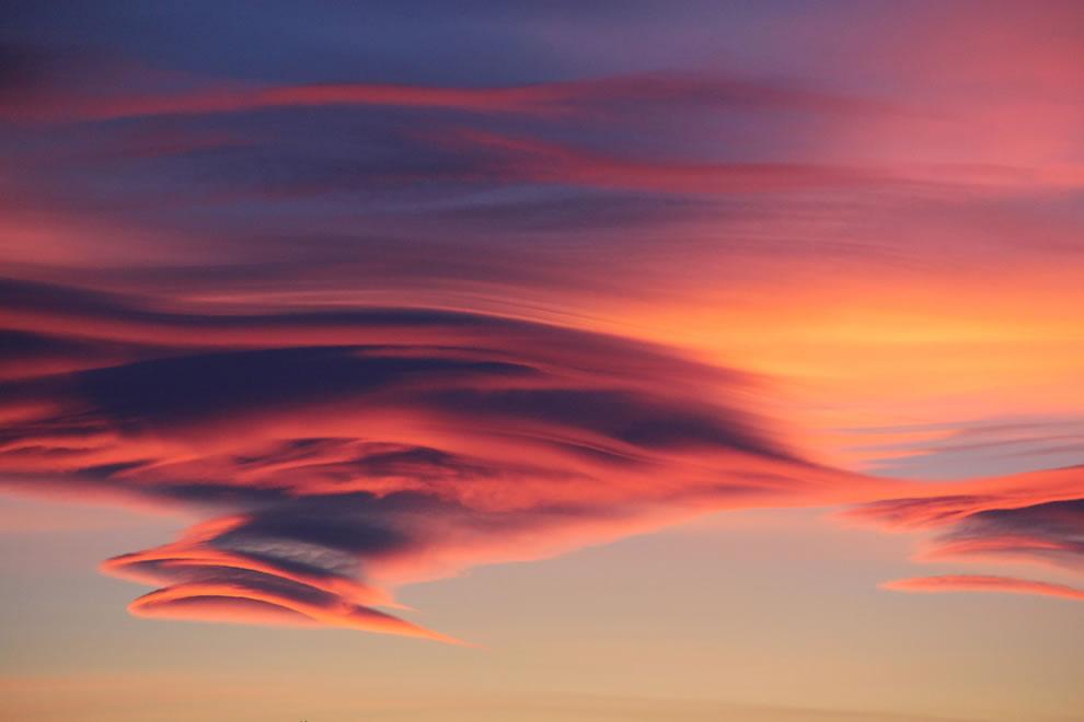 Hot pink lenticular cloud sunset over Antarctica