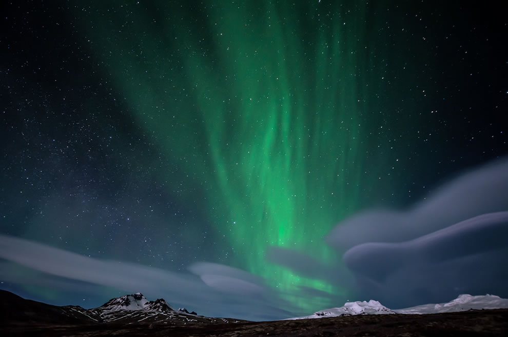 Northern lights and lenticular clouds over Skaftafell National Park, Iceland