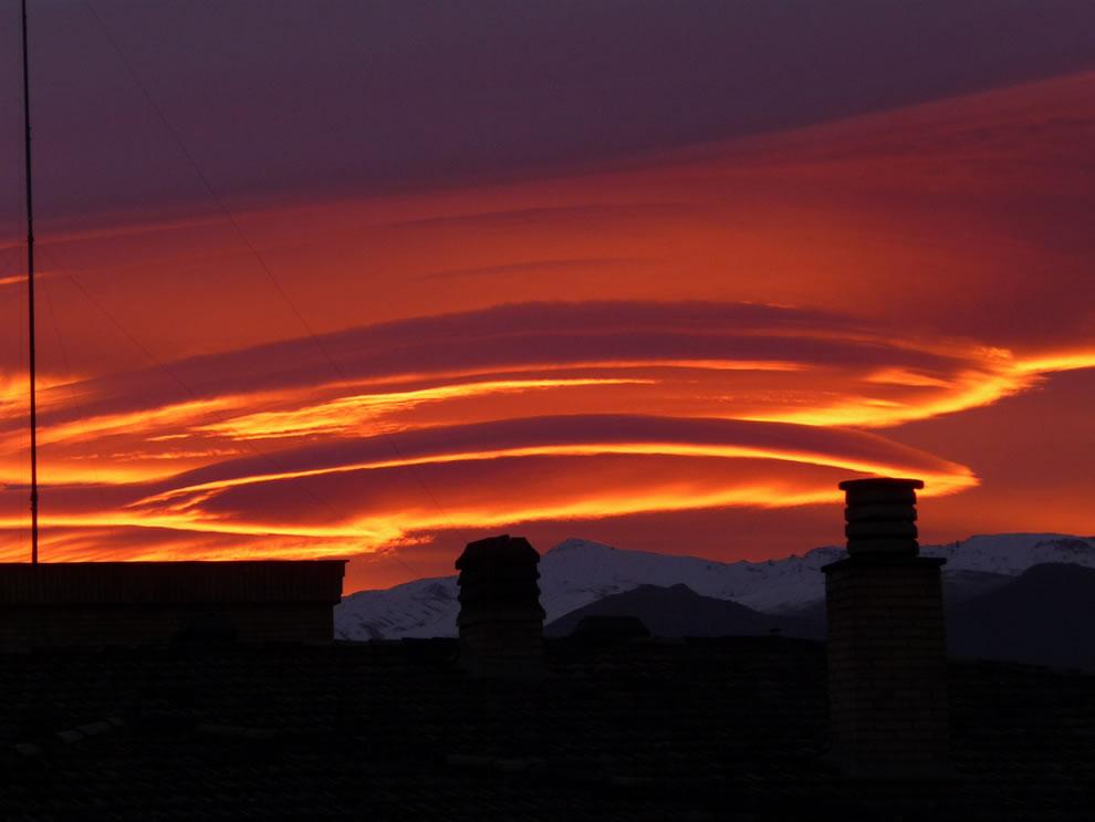 Orange sunrise and UFO clouds over Sierra Nevada