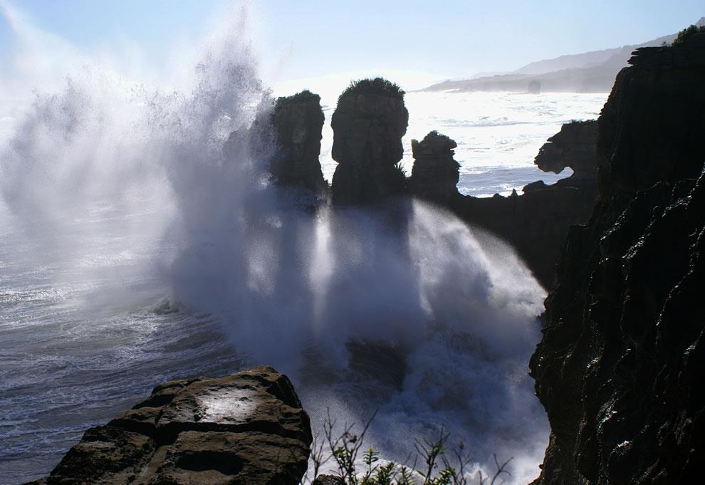 Waves crashing at Pancake Rocks near Punakaiki, New Zealand
