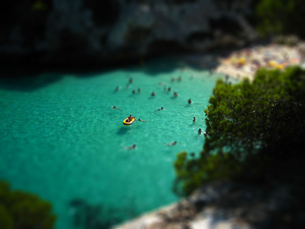 Miniature of people playing in the waters of Cala Macarelleta, Menorca