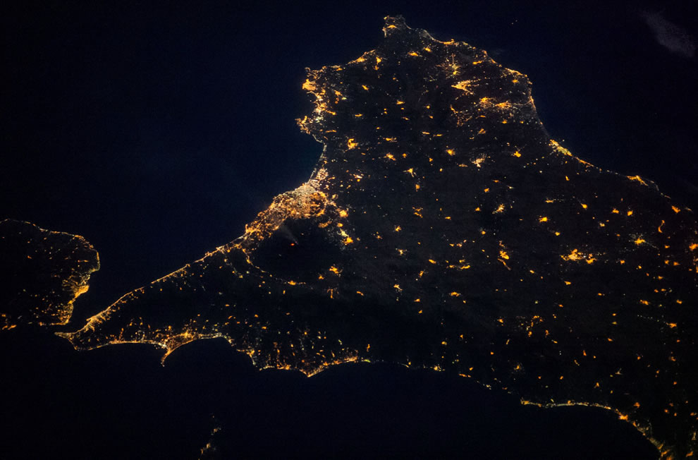 Mount Etna lava from space at night