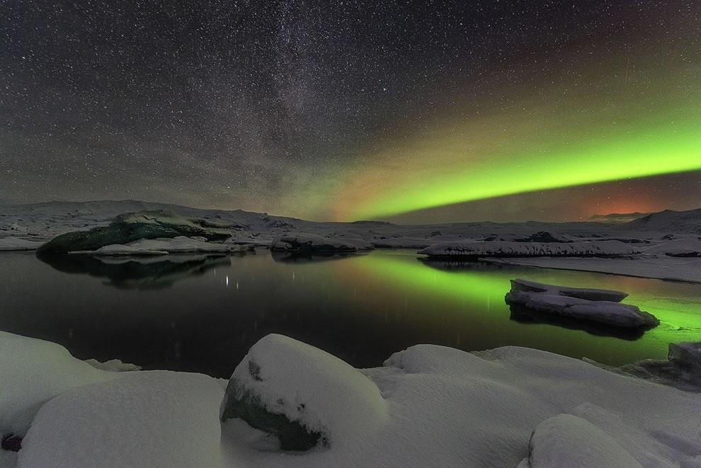 Milky Way, aurora and volcano glow