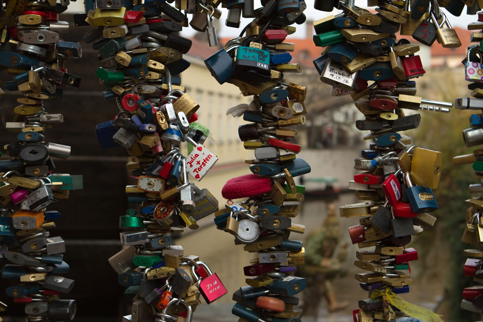 Love locks on a small bridge near the Lennon Wall in Prague, Czech Republic