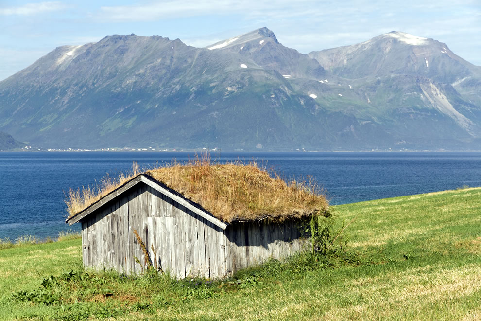 shed with hay roof (a kind of green roof) at Ullsfjorden, Lyngen municipality, Troms, Norway